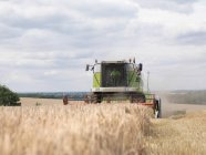 Combine Harvester In Wheat Field — Stock Photo