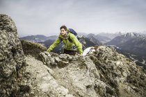 Young male hiker on Klammspitze mountain, Oberammergau, Bavaria, Germany — Stock Photo