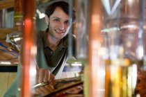 Male brewer working in beer brewhouse — Stock Photo