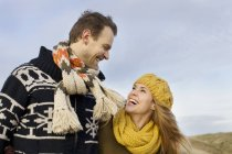 Smiling mid adult couple at coast in winter — Stock Photo