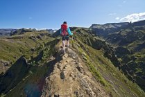 Woman hiking up to Fimmvordurhals Pass above Thorsmork Valley, Thorsmork, South Iceland, Iceland — Stock Photo