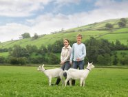 Boy And Girl with Goats — Stock Photo