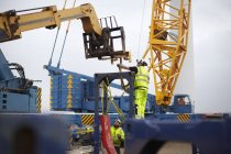 Engineers working at wind farm construction site — Stock Photo