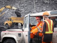 Coal Miners With Landrover In Mine — Stock Photo