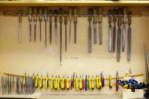 Carpentry tools stored in handmade cupboard — Stock Photo