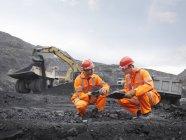 Coal Miners Inspecting Coal — Stock Photo