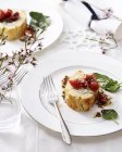 Goat cheese roulade with tomatoes and basil on elegant plate — Stock Photo