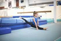 Young gymnast practising moves — Stock Photo