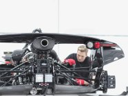Engineer assembling supercar in sports car factory — Stock Photo