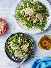 Fresh pear, blue cheese and hazelnut salad on table — Stock Photo