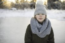 Portrait of young girl in snowy landscape — Stock Photo