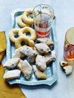 Still life with plate of Italian zaletti and bussolai on wooden table — Stock Photo