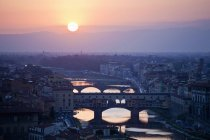 Cityscape with Arno river at sunset, Florence, Tuscany, Italy — Stock Photo