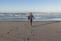 Man walking on beach — Stock Photo