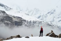 Rear view of woman standing and looking at view,  Annapurna Base Camp trek, Nepal — Stock Photo