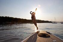 Woman diving from boat, Cannes Islands, Cote D'Azur, France — Stockfoto