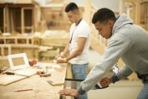 Two male college students in woodworking workshop — Stock Photo