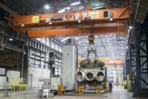 Large casting on crane in engineering factory — Stock Photo