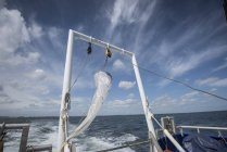 Plankton net hanging on stern of research ship — Stock Photo