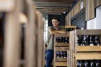 Mid adult man working in liquor warehouse — Stock Photo