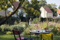 Mature woman gardening outdoors at daytime — Stock Photo