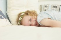 Portrait of girl lying on seat in holiday apartment — Stock Photo