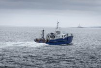Distant view of Research ship at sea — Stock Photo