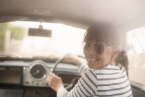 Smiling Woman driving a car — Stock Photo
