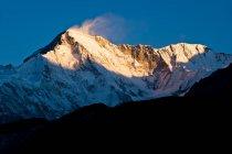 Snowy mountains overlooking valley — Stock Photo