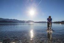 Woman trying the water at Nahuel Huapi Lake in Patagonia — Stock Photo