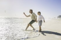Father and son on beach — Stock Photo
