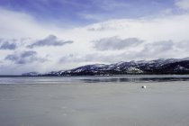 Lake Tahoe and mountains under cloudy sky in winter — Stock Photo