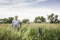 Portrait of male farmer on edge of a field — Stock Photo