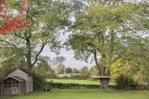 Garden in countryside landscape — Stock Photo
