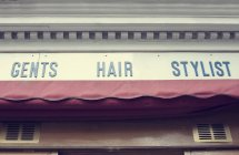 Bottom view of Barbershop sign and awning — Stock Photo
