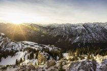 Snow-covered mountain landscape at sunrise, Teufelstattkopf mountain, Oberammergau, Bavaria, Germany — Stock Photo