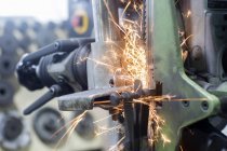 Close up of Sparks on grinding machine — Stock Photo