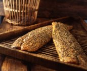 Peppered mackerel on a wooden board, close-up — Stock Photo
