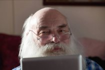 Portrait of Senior man using digital tablet — Stock Photo