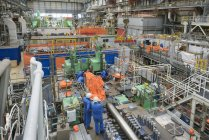 Engineers working on turbine housing repair during power station outage, high angle view — Stock Photo