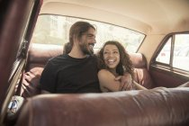 Young couple on road trip in vintage car back seat, Cape Town, South Africa — Stock Photo