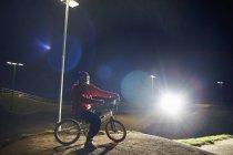 BMX-cyclist riding at night time — Stock Photo