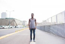Full length portrait of man in urban area looking away, Milan, Italy — Stock Photo