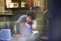 Male caucasian Glassblower creating artwork — Stock Photo