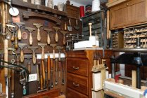 Selection of tools and equipment in traditional bookbinding workshop — Stock Photo
