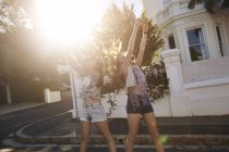 Teenage girls taking selfies in street, Cape Town, South Africa — Stock Photo