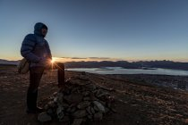 Man climbing a summit near Tromso in autumn, Arctic Norway — Stock Photo
