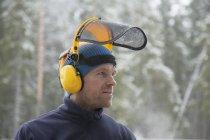 Logger wearing safety visor in forest, Tammela, Forssa, Finland — Stock Photo