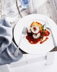 Plate of chicken involtini with tomato — Stock Photo