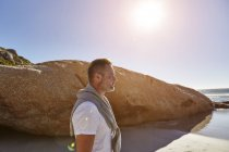 Mature man standing on beach, looking at view, Cape Town, South Africa — Stock Photo